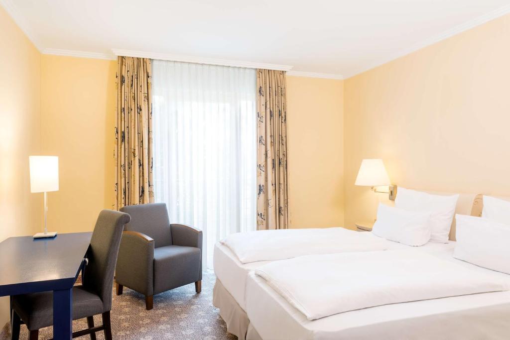 Ein Bett oder Betten in einem Zimmer der Unterkunft NH Potsdam