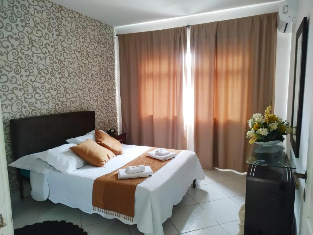 A bed or beds in a room at Apartamento espaçoso localizado no Centro de Angra dos Reis