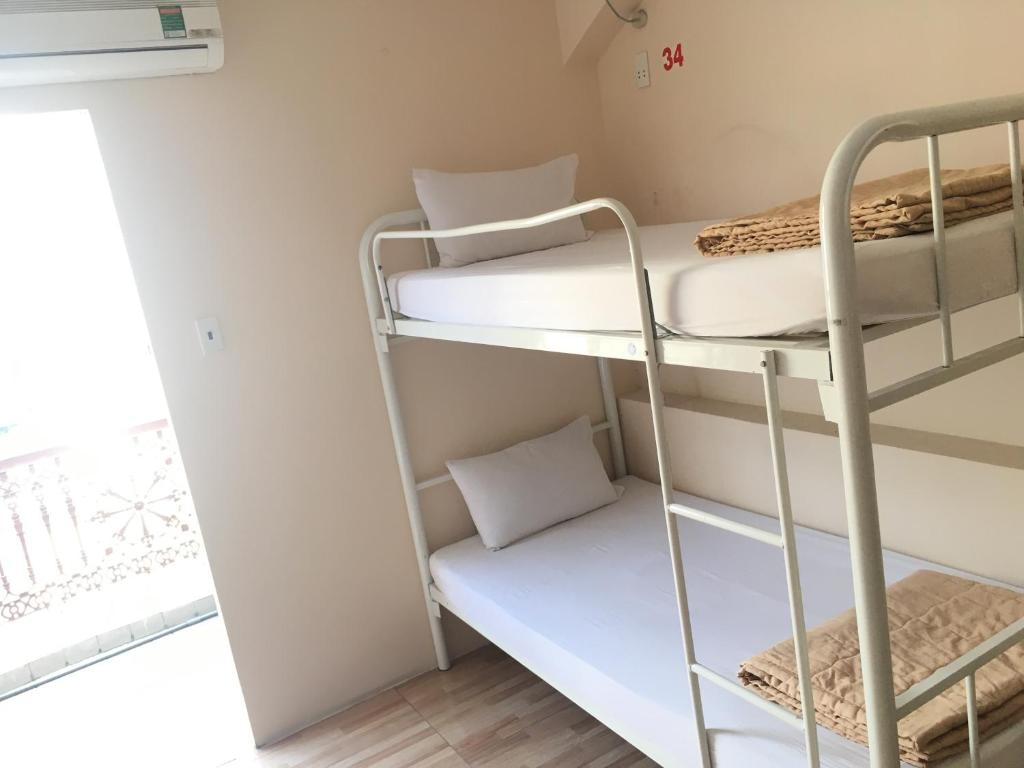 A bunk bed or bunk beds in a room at Saigon Fantastic Hostel