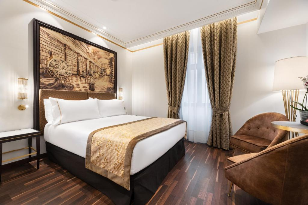 A bed or beds in a room at Eurostars Legends