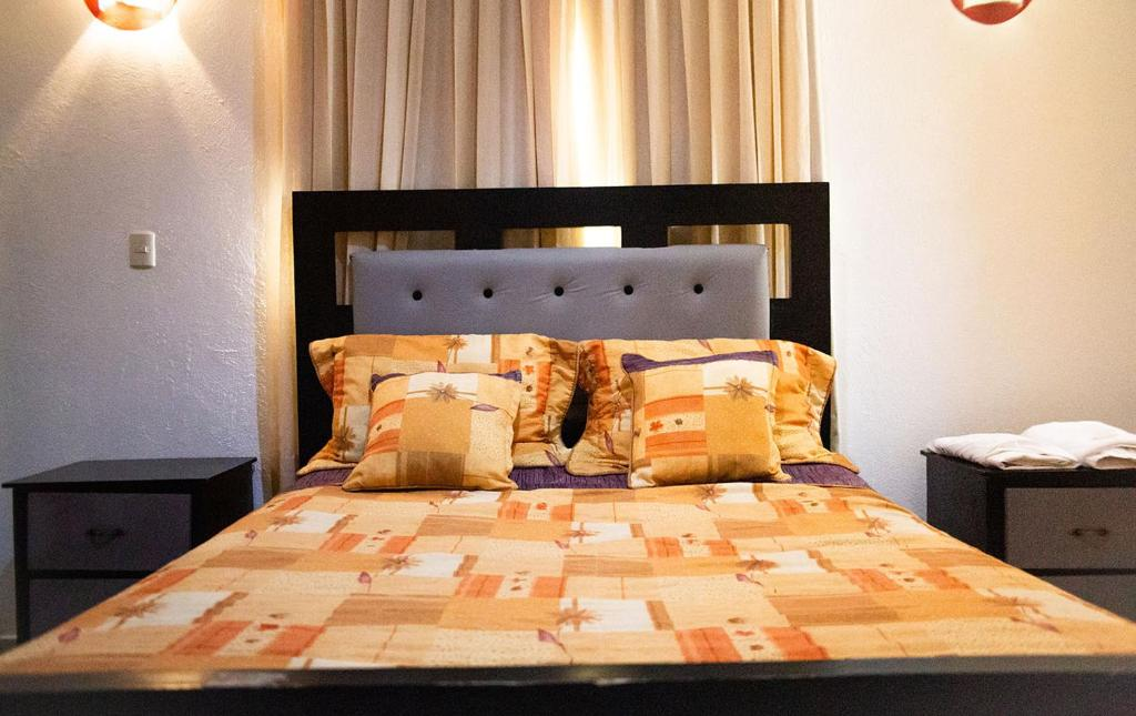 A bed or beds in a room at Hotel Gold Premium