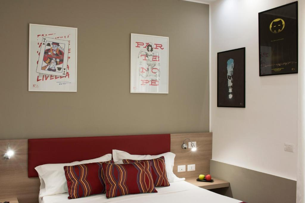 A bed or beds in a room at Neapolitan Republic Suite