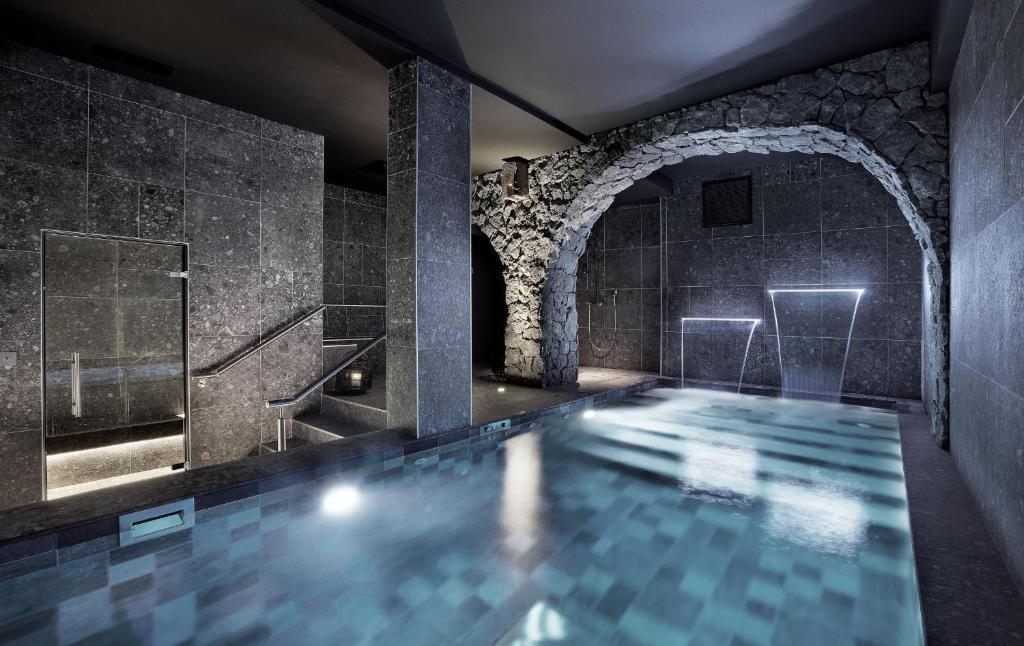 The swimming pool at or near Petit Hôtel Confidentiel