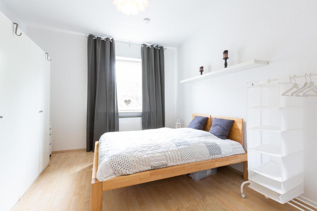Ein Bett oder Betten in einem Zimmer der Unterkunft Deutsche Messe Zimmer - Private Apartments Hannover Exhibition Center (room agency)