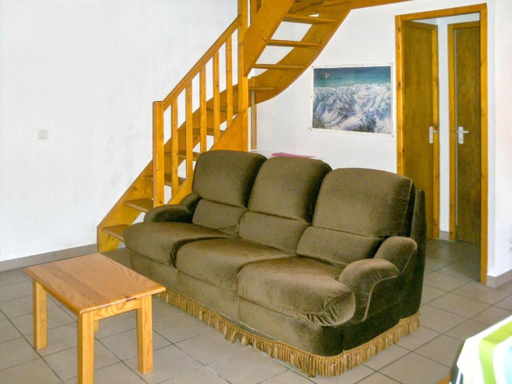 A seating area at Holiday Home Hameau des Ecureuils
