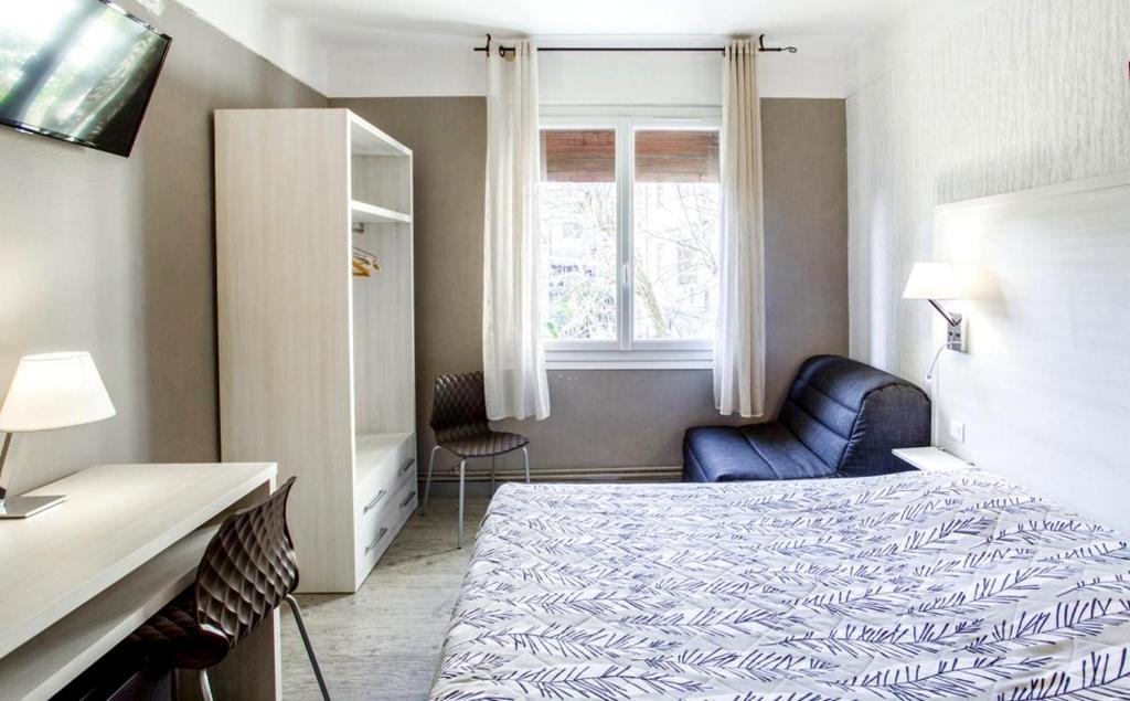 Un ou plusieurs lits dans un hébergement de l'établissement Le Provençal