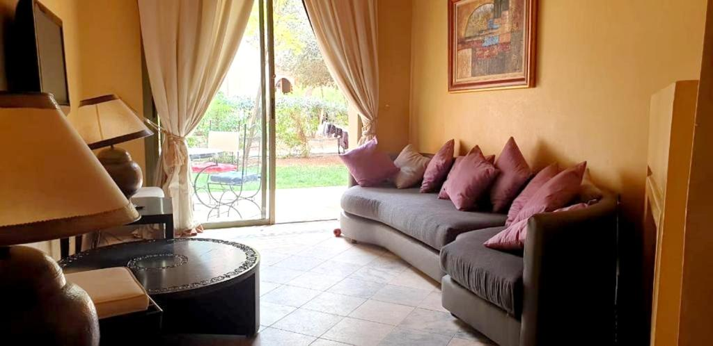 A seating area at Apartment with 2 bedrooms in Marrakesh with shared pool and enclosed garden