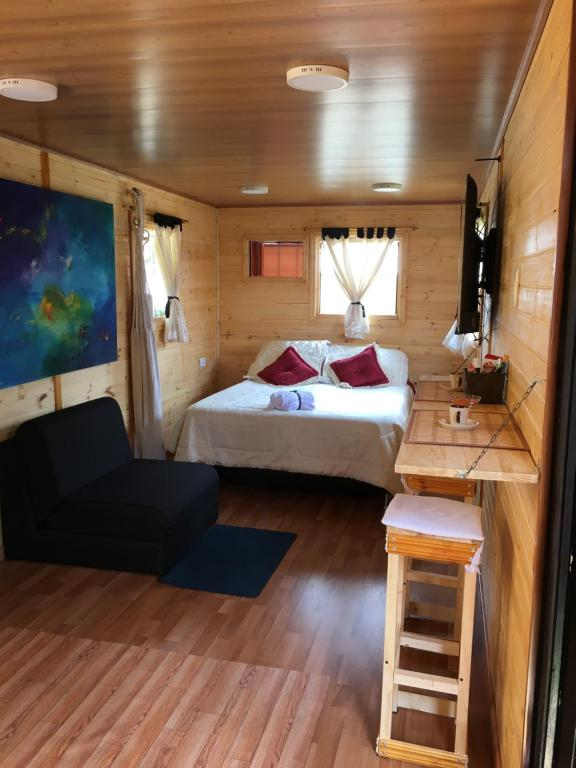A bed or beds in a room at Casa Trailer Cadata