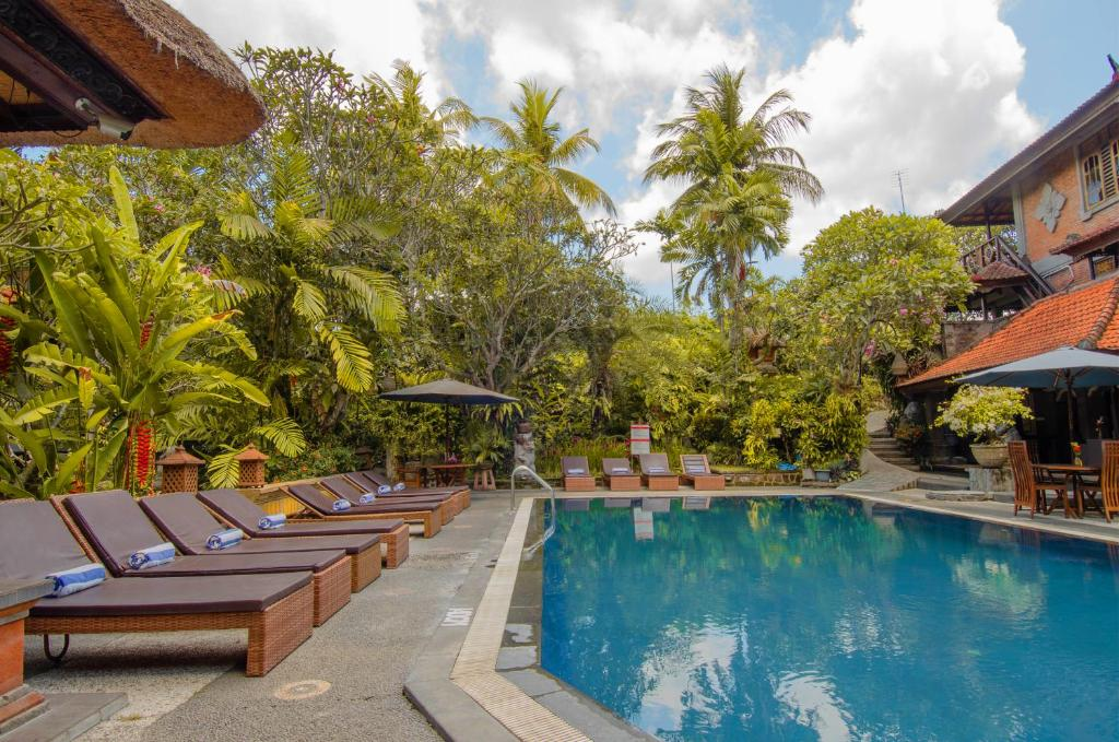 The swimming pool at or near Artini 2 Cottage Ubud