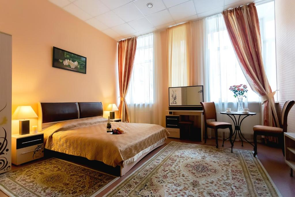 Кровать или кровати в номере Comfort City