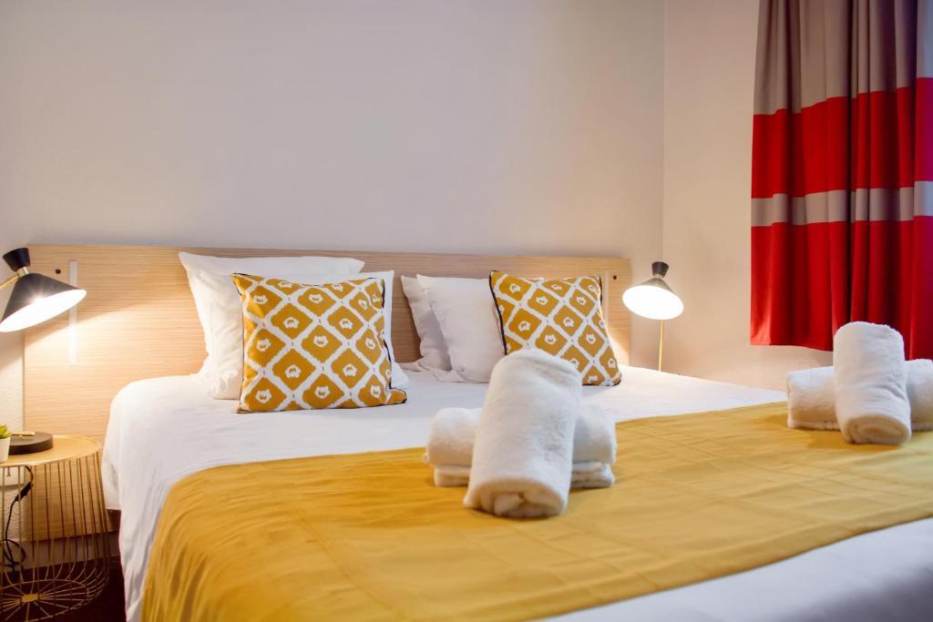Кровать или кровати в номере Appart'City Confort Lille - Euralille
