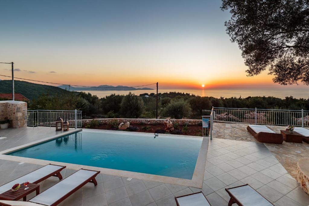 The swimming pool at or near Luxury Private Stone Villa Alex