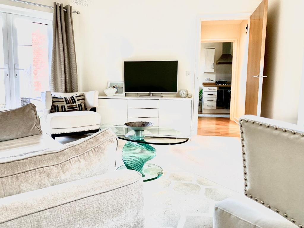 A television and/or entertainment center at Luxury at the lawns Reading