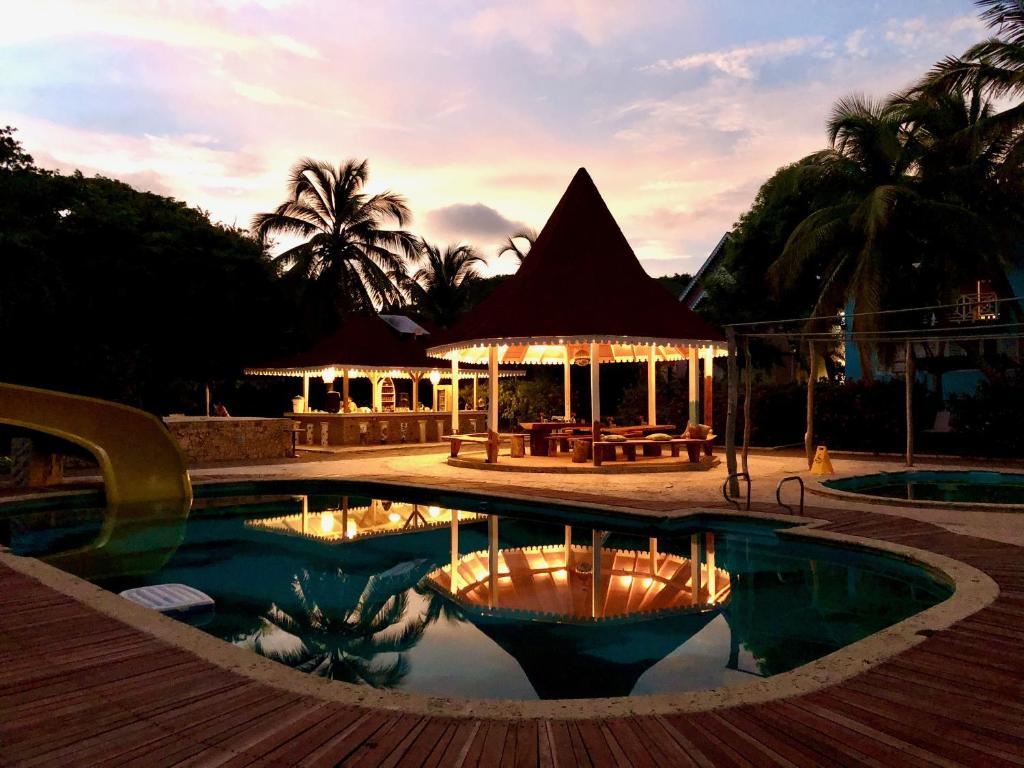 The swimming pool at or near Secreto Hostel