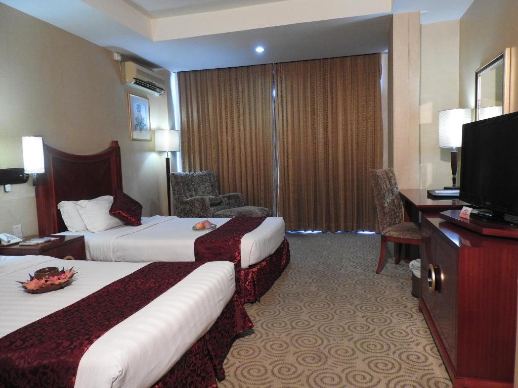 A bed or beds in a room at Crown Vista Hotel