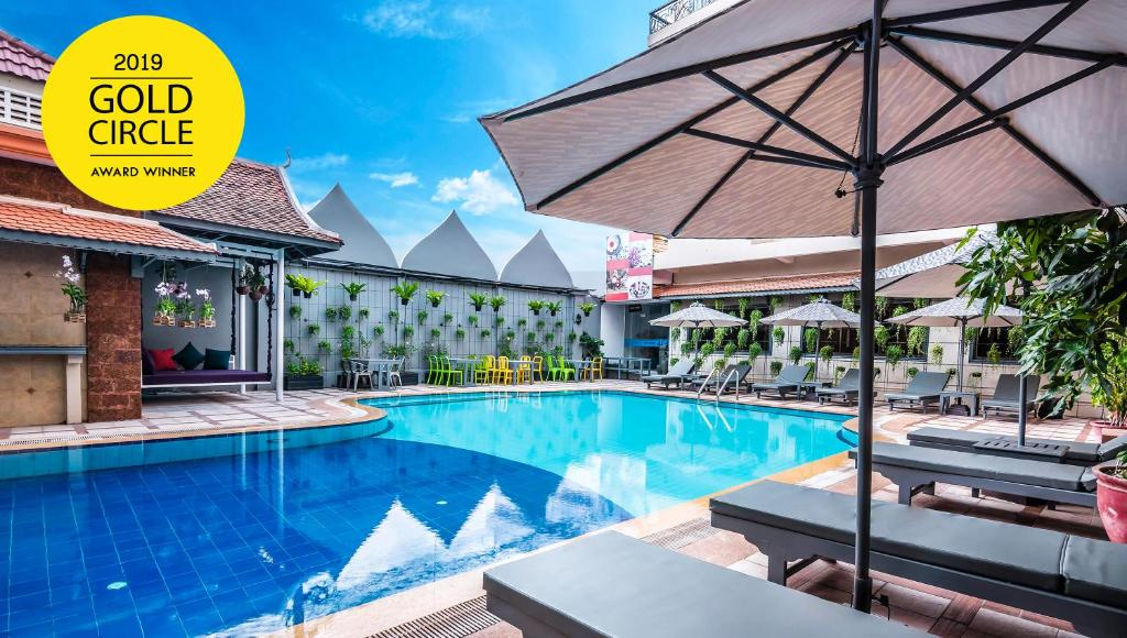 The swimming pool at or near Memoire Siem Reap Hotel