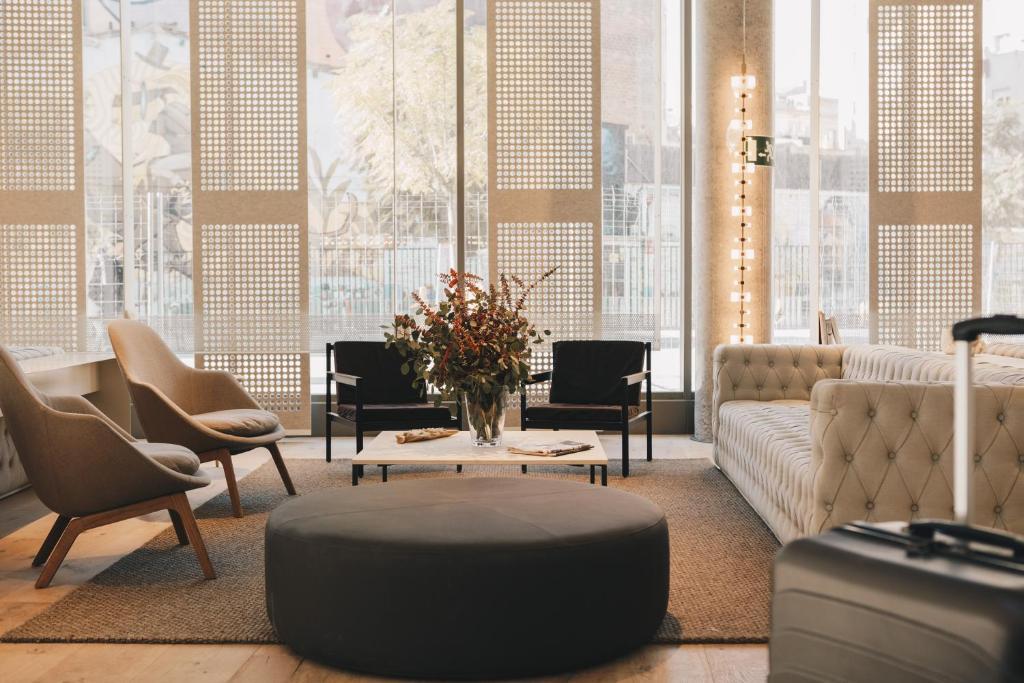 Ein Sitzbereich in der Unterkunft Ona Hotels Terra