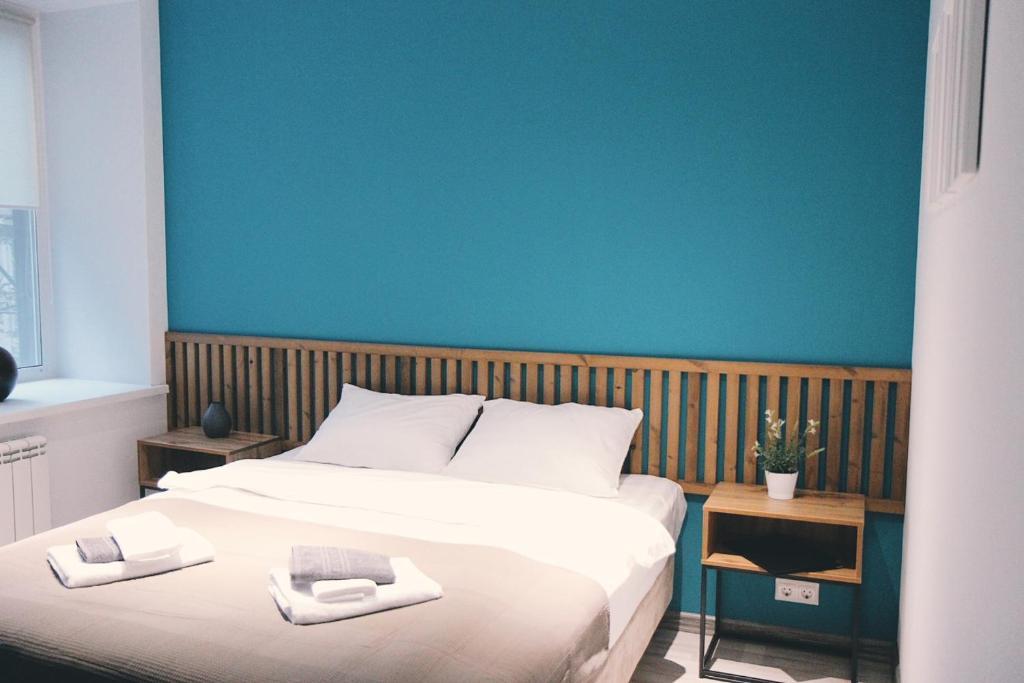 Ein Bett oder Betten in einem Zimmer der Unterkunft хостел Hi Loft