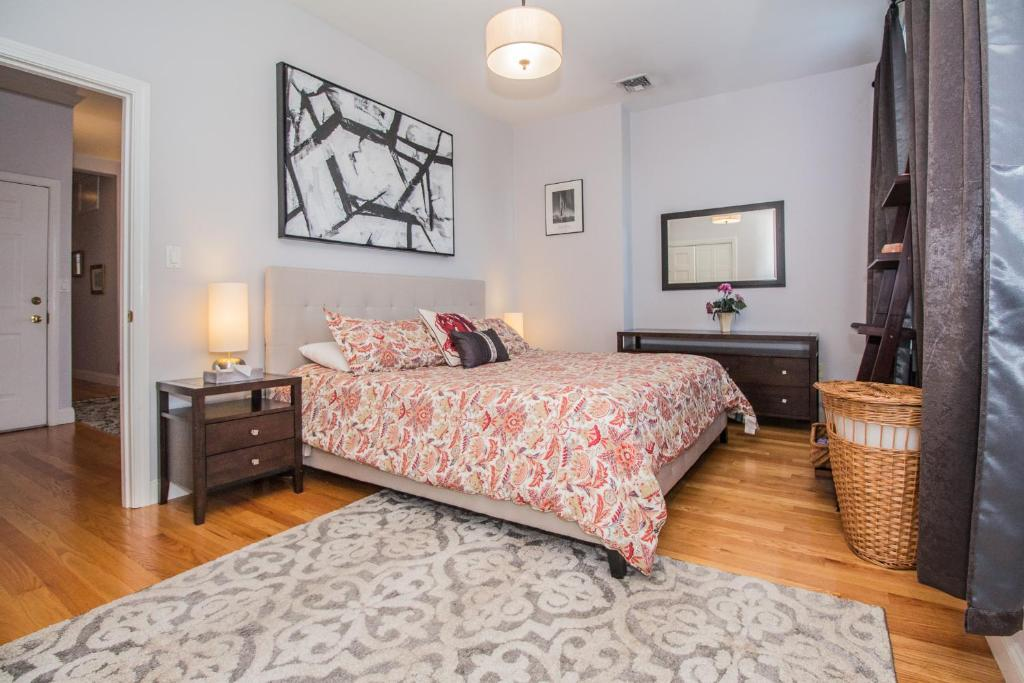 A bed or beds in a room at Brookline Village 2 Bedroom by STARS of Boston
