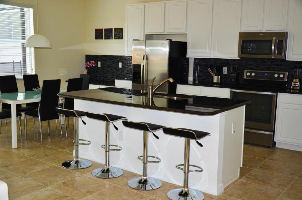 A cozinha ou cozinha compacta de Bella Vida Resort by FVH