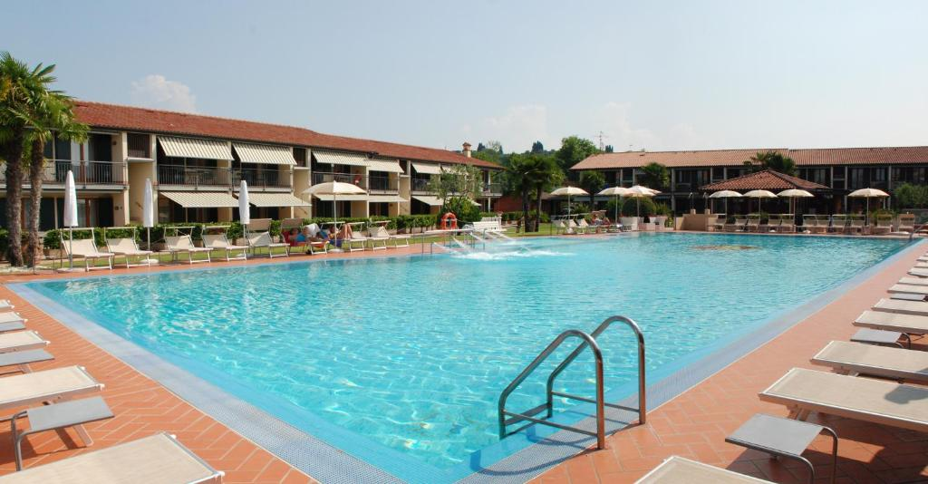 The swimming pool at or near Residence La Margherita