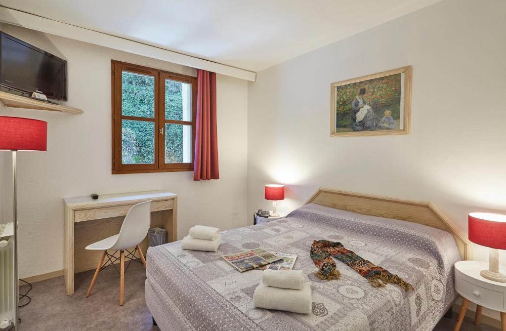 Un ou plusieurs lits dans un hébergement de l'établissement Hôtel National