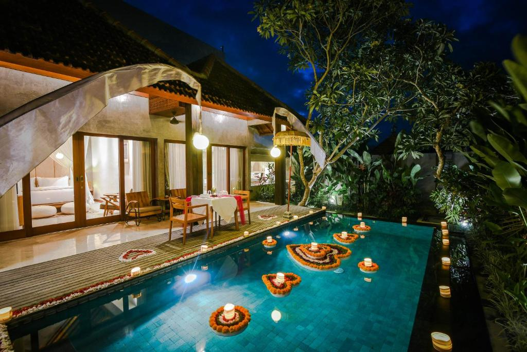 The swimming pool at or near Purana Suite Ubud