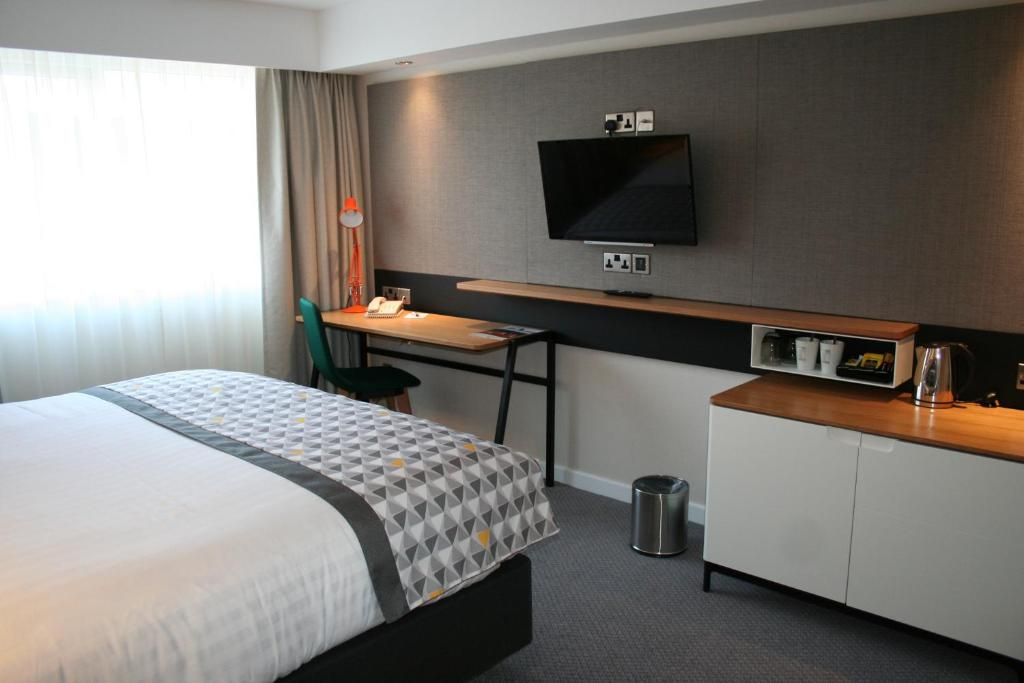A television and/or entertainment center at Holiday Inn South Normanton M1, Jct.28