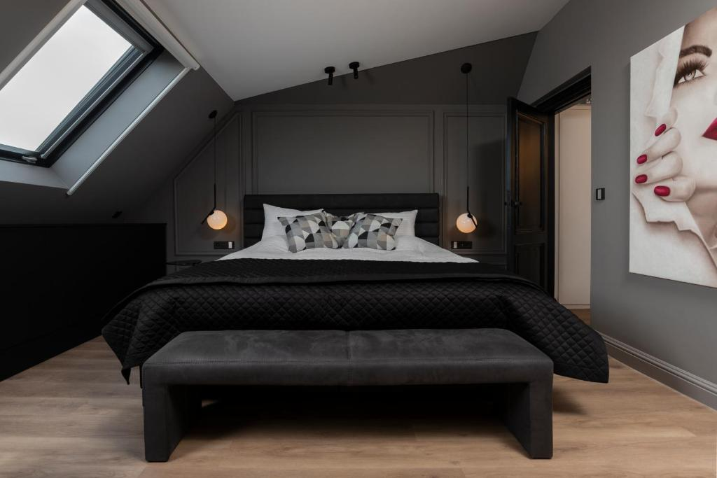 A bed or beds in a room at Lit d'Art Exclusive Boutique Hotel