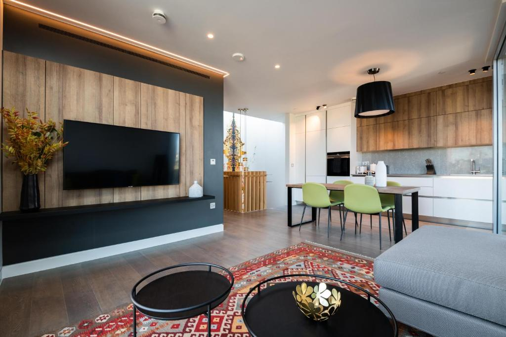 A television and/or entertainment centre at Mirabilis Apartments - Bayham Place