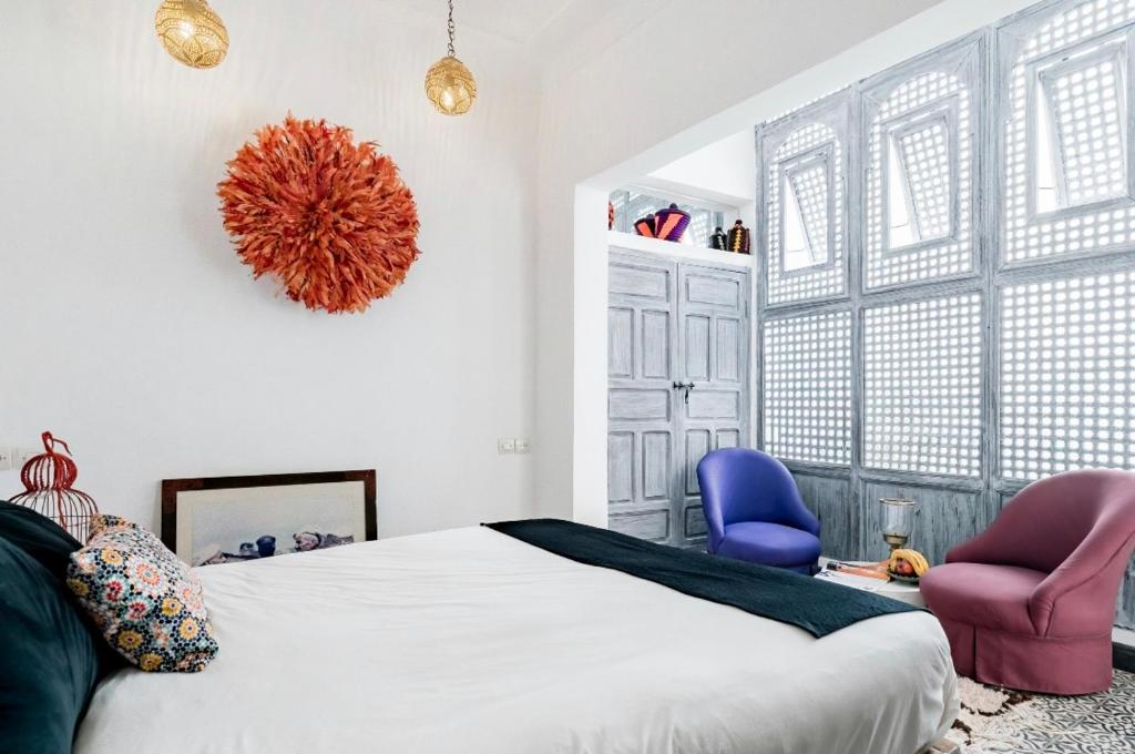 A bed or beds in a room at Riad Dar Mtiwla