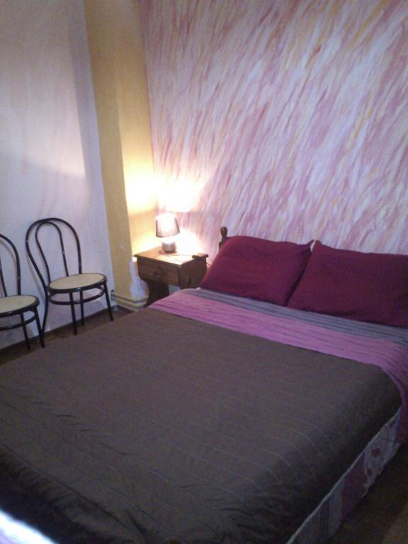 A bed or beds in a room at Sun Corfu