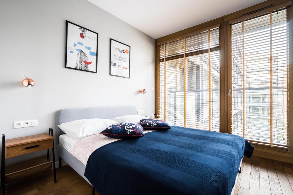Postel nebo postele na pokoji v ubytování Old Town Heart IV Luxury - Kolejowa