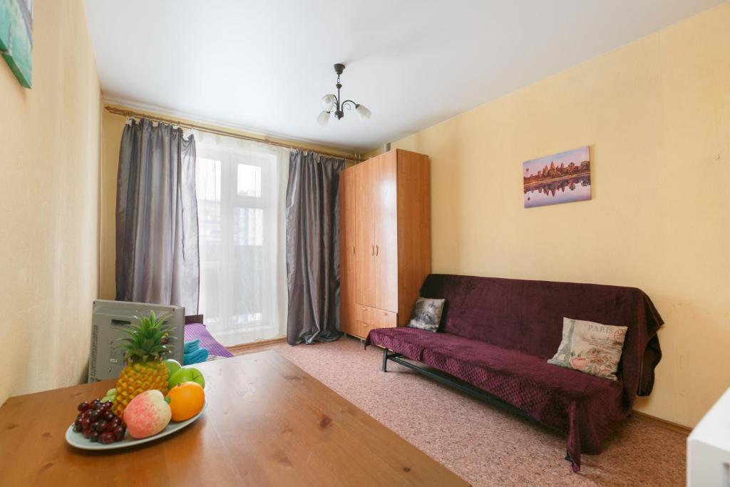 A seating area at Квартира в новом доме Одоевского 1 10