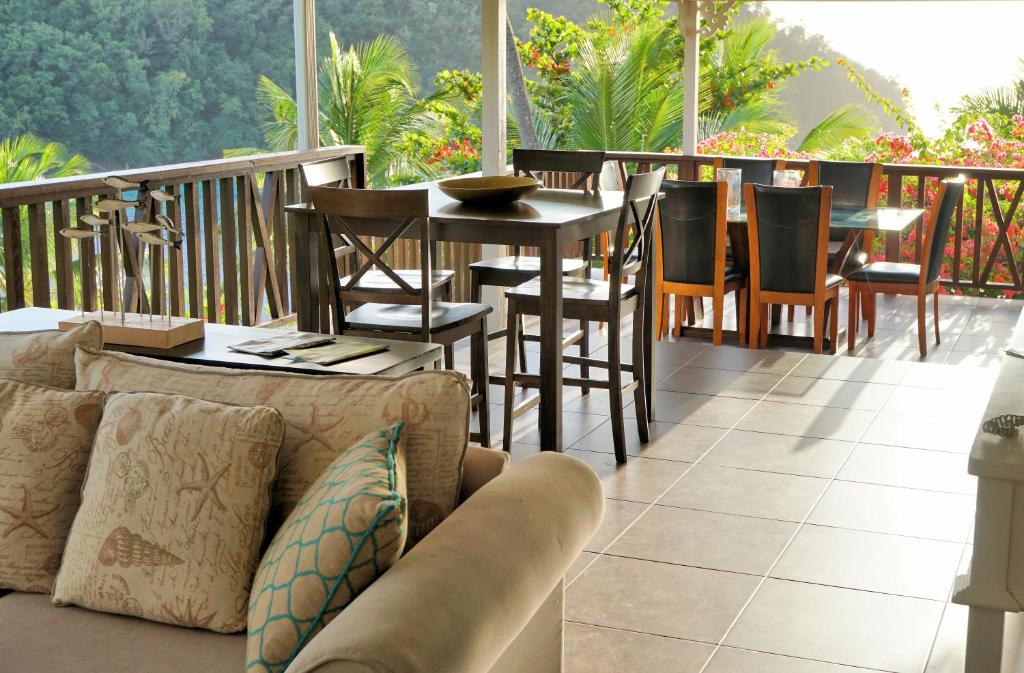 A restaurant or other place to eat at Marigot Beach Club & Dive Resort