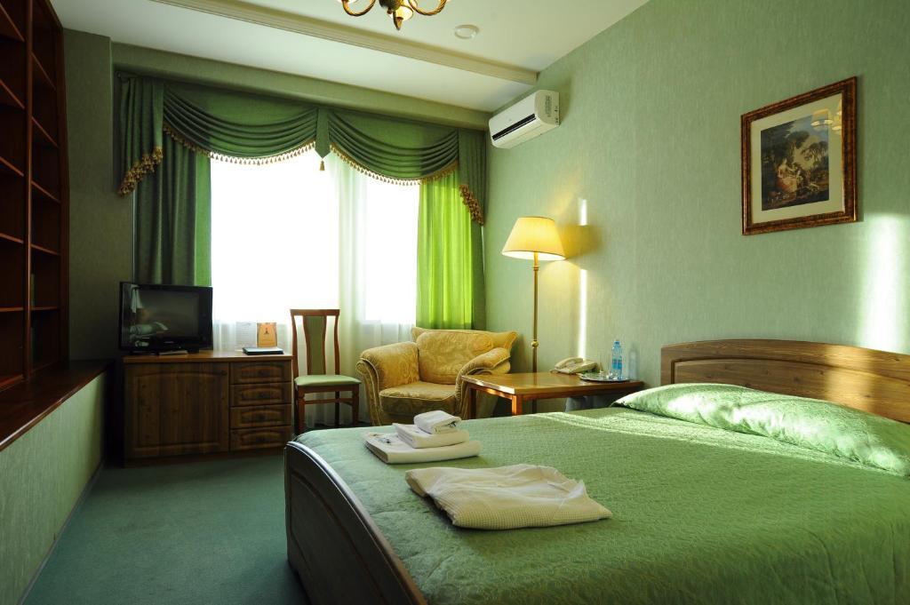 Ein Bett oder Betten in einem Zimmer der Unterkunft Hotel Lermontov