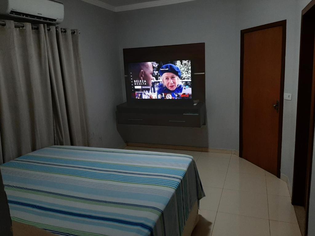 Cama o camas de una habitación en Casa Aconchegante