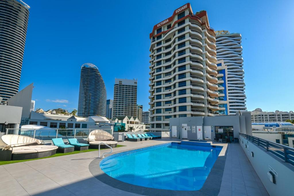 The swimming pool at or near Victoria Square Apartments