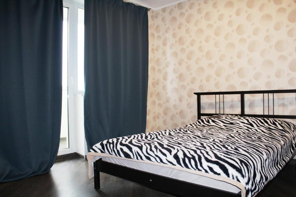 A bed or beds in a room at Loft na jubilee 40-2