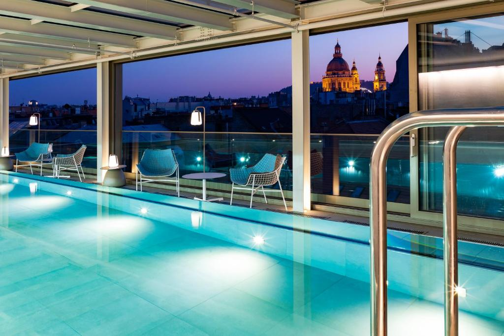 The swimming pool at or near Cortile Budapest Hotel