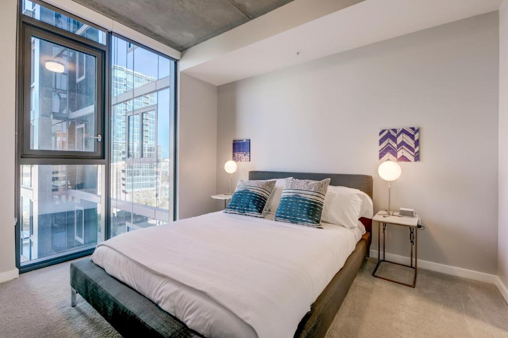 A bed or beds in a room at Mint House Downtown Denver