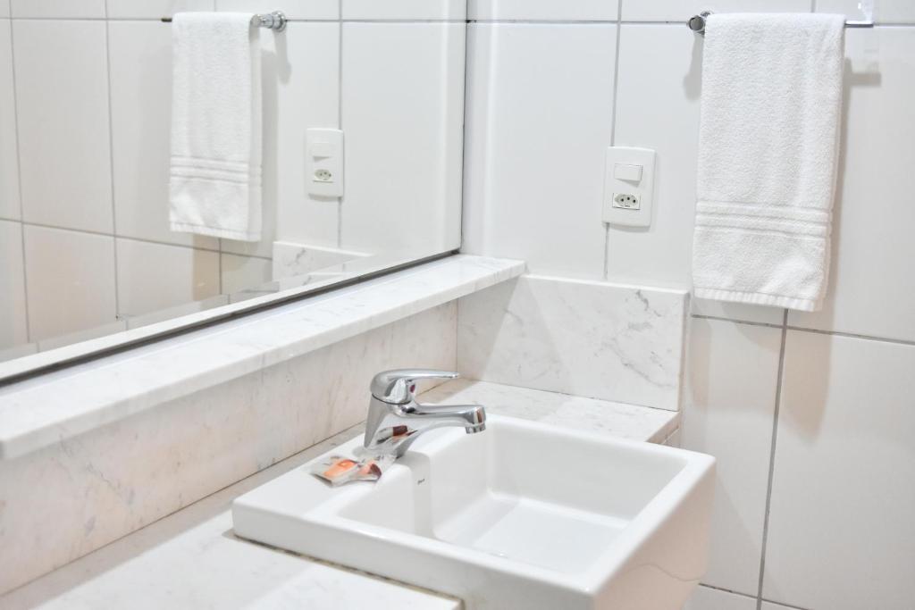 Um banheiro em Cordilheira Hotel
