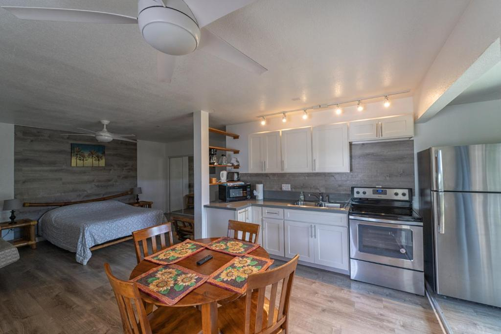 A kitchen or kitchenette at Puu Koa Palms vacation rental