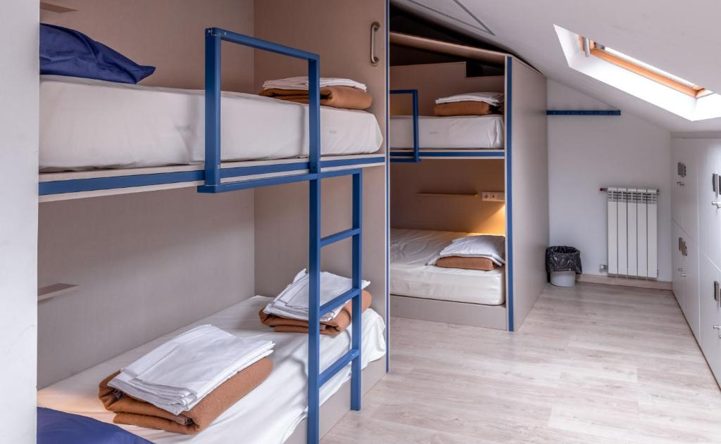 A bunk bed or bunk beds in a room at Santiago KM-0