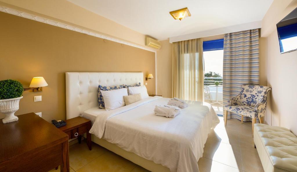 Кровать или кровати в номере Secret Paradise Hotel & Spa