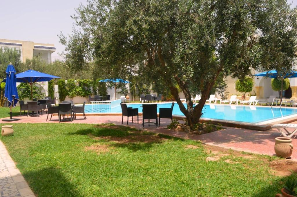 The swimming pool at or near Residence Romane