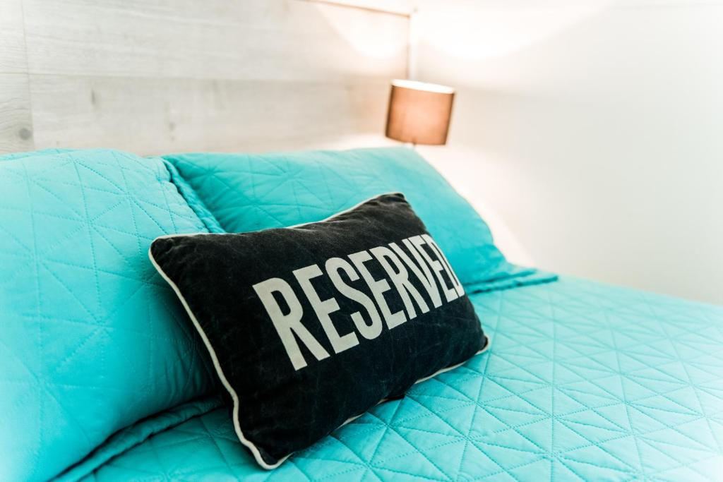 A bed or beds in a room at The Retreat Port Stephens