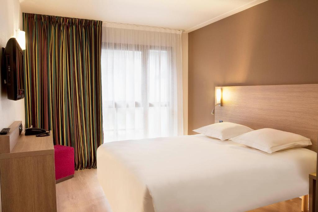 Ein Bett oder Betten in einem Zimmer der Unterkunft Escale Oceania Orléans