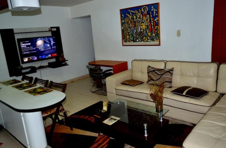 A seating area at Confortable apto tipo Suite/ Turismo Relax