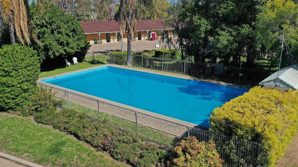 The swimming pool at or near Burke and Wills Motor Inn